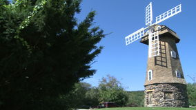Large stone windmill (1 of 3). A view or scene on the farm stock video