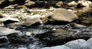 Large stones, boulders and boulders in the Bode near Thale, as places for rest, contemplation and meditation.  stock photography