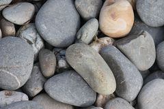Large stones and rocks on a sandy beach background Stock Photos