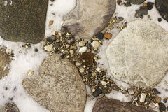 Large stones in the snow Stock Image