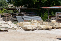 Large stones stacked in piles to be used to build house Royalty Free Stock Photos