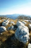 Large stones on top of the mountain. Landscape from the top of Pt in the mountain range of Orien in Montenegro Royalty Free Stock Image