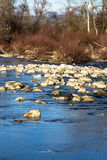 Large stones in the water. A lot of rocks photographed in the water west morava Stock Photography