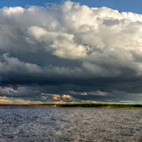 Large storm cloud over a large lake Stock Photo