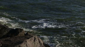 Large storm sea waves breaking on the rocks. Large storm sea waves breaking on rocks stock video