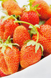 Large strawberries in the plate Stock Photo
