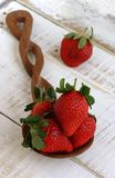 Large strawberries on a wooden spoon Royalty Free Stock Image