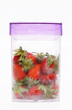 Large strawberry in the transparent container Stock Photo