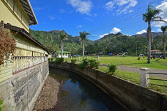 Large stream or drain behind Royal Hotel, Levuka, Fiji. This image is taken behind Royal Hotel with large green field on the right where children are playing royalty free stock photography
