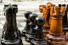 Large street chess figures on the board including pawns, rook an Stock Photos