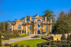 Large Stucco House on Hill stock images