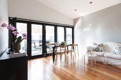 Large studio apartment living room with bi fold doors Royalty Free Stock Image