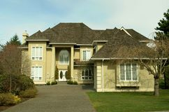 Large Suburban House. Nice stucco home in a Vancouver, BC subdivision royalty free stock images