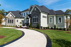 Large suburban house. With driveway Royalty Free Stock Photos