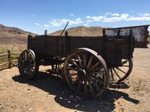 Large Supply Wagon. Very old wooden supply wagon in Calico Ghost silver mining Stock Photos