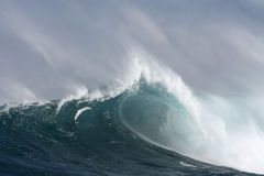Large surf wave with barrel and wind. Royalty Free Stock Images