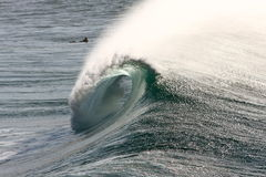 Large surf wave breaking with barrel view. Large wave breaking in surf, giving view through barrel Stock Images