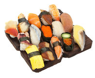 Large Sushi Sampler. A selection of 15 various pieces of sushi/sashimi on a wooden block Royalty Free Stock Photos