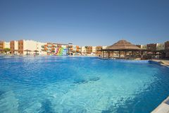 Swimming pool with bar in a luxury tropical hotel resort Royalty Free Stock Photography