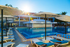 Large swimming pool with bar at european tropical hotel resort Royalty Free Stock Images