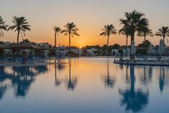 Large swimming pool in a luxury tropical hotel resort at sunrise Royalty Free Stock Photography