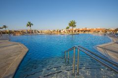 Large swimming pool in a luxury tropical hotel resort Stock Photography