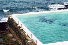 Large swimming pool by the sea Royalty Free Stock Image