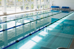 Large swimming pool with sunlight streaming in Stock Photography