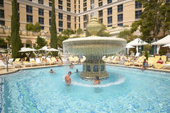 Large swimming pool with swimmers at Bellagio Casino in Las Vegas, NV Stock Photography