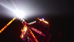 Large swinging ride in motion with people stock video