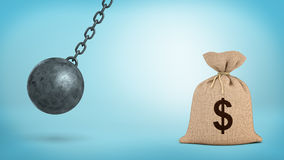 A large swinging wrecking ball on blue background beside a giant money bag with a USD sign. Money in danger. Banking insurance. Best saving plan Royalty Free Stock Images