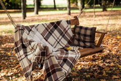 Large swings with a cozy blanket Stock Photos