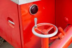 Large swivel handle to extend the support. Mechanical rotary knob to extend the support of the old fire truck royalty free stock images