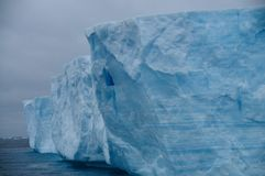 Giant Tabular Iceberg in the Anarctic Weddell Sea. A large tabular iceberg floating in the southern atlantic ocean, near Antarctica Stock Images