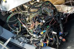 A large tangle of ravel multicolored wires from the car wiring royalty free stock image