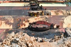 Large tank for gasoline in the excavated quarry for storage of petroleum products.  stock image