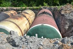 Large tank for gasoline in the excavated quarry for storage of petroleum products.  royalty free stock photo
