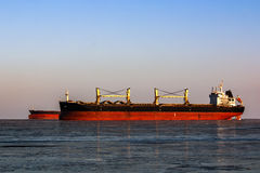 Large tanker in the queue for loading of oil in icy sea Royalty Free Stock Image