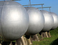 Large tanks of a methane gas storage for energy supply. Very large tanks of a methane gas storage for energy supply Royalty Free Stock Images