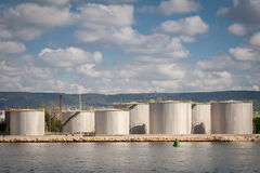 Large tanks for petrol and oil, cloudy sky Royalty Free Stock Photography