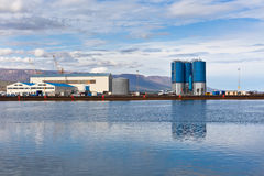 Large tanks and wirehouses at sea commercial dock in North Icela Royalty Free Stock Images