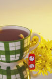 Large tea mug with yellow flower close Royalty Free Stock Images
