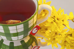 Large tea mug with yellow flower top Stock Photo