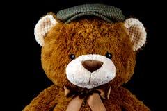 Large Teddy Bear Wearing a Flat Cap. Large brown stuffed bear wearing a flat cap stock photography