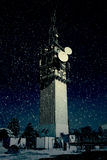 Large Telecommunications Tower in Snow Stock Image