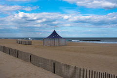 A Large Tent on the Beach. A large tent on an empty beach on a spring morning Stock Photos