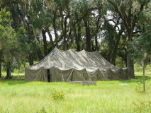 Large Tent in the Oaks. Large old tent among live oak trees with Spanish moss in a park setting Stock Photos