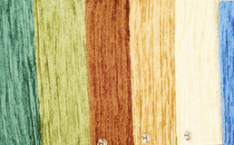 Large textile samples. Line of colorful textile samples in a row. Image  on white as a closeup image Royalty Free Stock Images