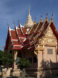 Large Thai temple soaring into blue sky royalty free stock photography