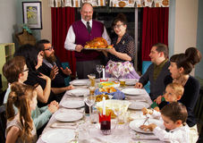 Large Retro Family Thanksgiving Dinner Turkey. Large family celebrates Thanksgiving dinner Royalty Free Stock Image